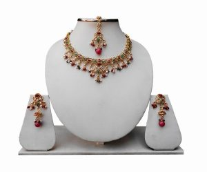 Polki Bridal Jewellery Set with Indian Tikka and Earrings in Red and Green Stones-0